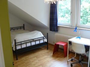 Ein Bett oder Betten in einem Zimmer der Unterkunft Ferienwohnung Weiken