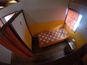 Cama ou camas em um quarto em PainaPaopao Backpacker