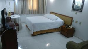 A bed or beds in a room at Obeid Plaza Hotel