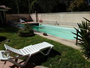 The swimming pool at or near Zona Calma e Relaxante... proxima do Porto
