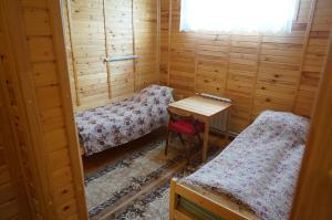 Кровать или кровати в номере Guest house Ustujanin & pomor