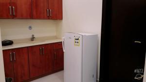 A cozinha ou cozinha compacta de أجنحة الرؤية للوحدات السكنية قصر النهضة سابقاً