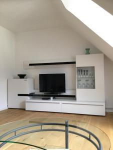 TV/Unterhaltungsangebot in der Unterkunft Apartment am Klinikum