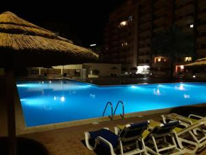 The swimming pool at or near Charme Paraíso Sol