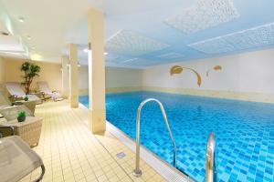The swimming pool at or near ACHAT Hotel Buchholz Hamburg
