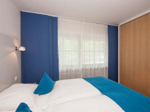 Ein Bett oder Betten in einem Zimmer der Unterkunft Alpenresidenz Buchenhöhe