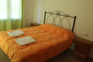 A bed or beds in a room at Apartamentos Turísticos Edificio del Pino