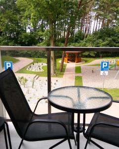 A balcony or terrace at Apartament Ku Morzu II Ustronie Morskie