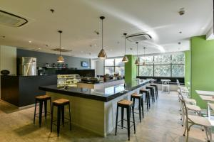 A restaurant or other place to eat at Urbanpod Hotel