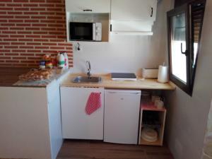 Una cocina o zona de cocina en Abadía del Marqués