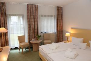 Ein Bett oder Betten in einem Zimmer der Unterkunft Lindenhotel Stralsund