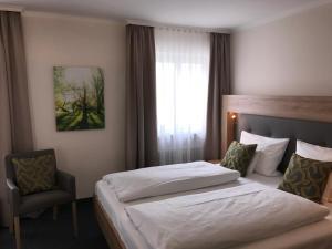 Ein Bett oder Betten in einem Zimmer der Unterkunft Hotel Kronprinz