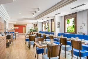 A restaurant or other place to eat at Novum Hotel Rega Stuttgart
