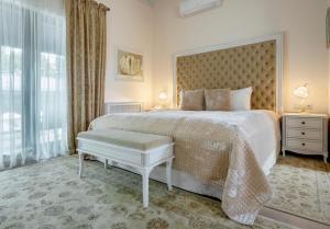 Lova arba lovos apgyvendinimo įstaigoje Hotel Pušų paunksnėje