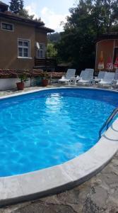 The swimming pool at or near Guest House Todorini kashti