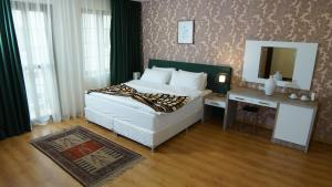 A bed or beds in a room at Khan Saray