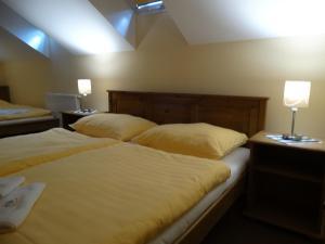 A bed or beds in a room at Penzion Poříčí