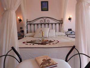 A bed or beds in a room at Casa de Trillo