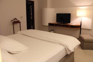 A bed or beds in a room at K108 Hotel Doha