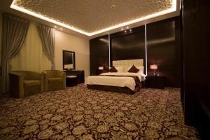 Cama ou camas em um quarto em Elaf Aparthotel