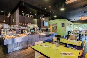 Restaurant ou autre lieu de restauration dans l'établissement Hotel des Congrès
