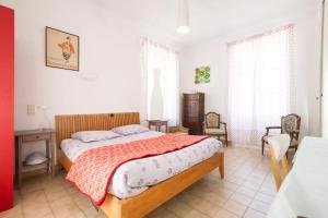 A bed or beds in a room at Gambetta Apartments