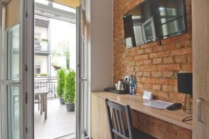 A kitchen or kitchenette at Apartamenty Leszno