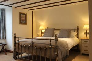 A bed or beds in a room at The Eagle House Hotel