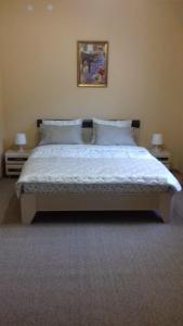Кровать или кровати в номере Гостевой дом Уютный уголок