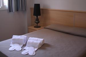 Cama o camas de una habitación en Aparthotel Marsol