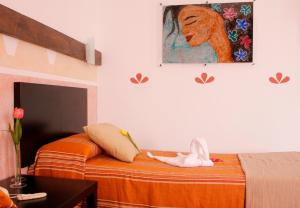 A bed or beds in a room at 4Dreams Hotel Chimisay