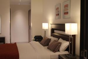 Cama ou camas em um quarto em Unique Suites