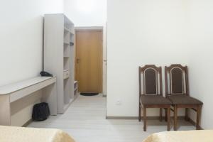 A television and/or entertainment center at Hotel Alma Ata