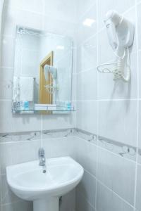 A bathroom at Hotel Alma Ata