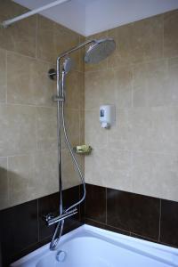 Ein Badezimmer in der Unterkunft Hotel Esplanada
