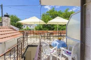 A balcony or terrace at Apartments and Rooms Iva