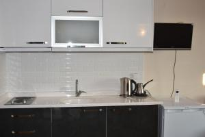 A kitchen or kitchenette at Dasis Hotel Suites