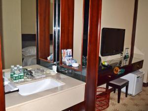 A bathroom at Osotto Recreation Hotel Baiyun