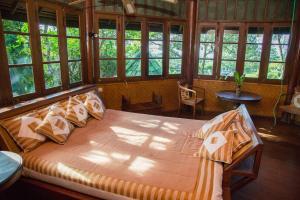 مطعم أو مكان آخر لتناول الطعام في Tirtagangga Water Palace Villas