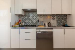 Cucina o angolo cottura di Panoramic Penthouse in the Centre