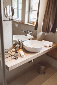 Ein Badezimmer in der Unterkunft Landhotel Lammershof