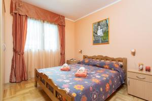 A bed or beds in a room at Djurovic Apartments Montenegro