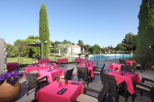A restaurant or other place to eat at Val Baussenc, The Originals Relais (Relais du Silence)