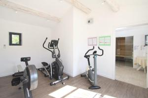 The fitness center and/or fitness facilities at Val Baussenc, The Originals Relais (Relais du Silence)