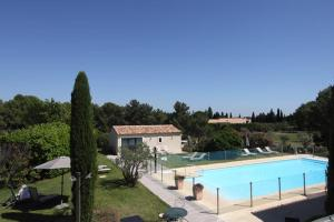 A view of the pool at Val Baussenc, The Originals Relais (Relais du Silence) or nearby