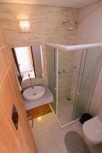 Um banheiro em Pousada Le Baron