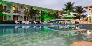 The swimming pool at or near Oceano Praia Hotel