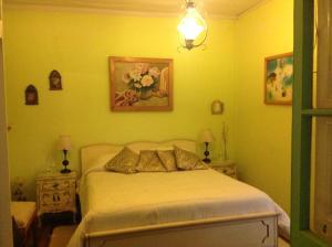 Cama o camas de una habitación en Hostal Renoir