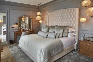 A bed or beds in a room at Lympstone Manor Hotel