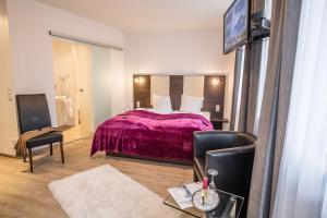 Een bed of bedden in een kamer bij Hotel SoleGARTEN